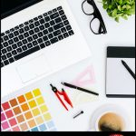 """This is a picture of a computer and other graphic design materials on a desk with the text """"Great graphics, easy terms"""""""